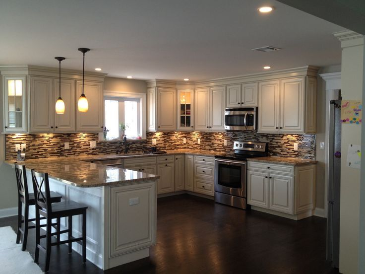 U Shaped Kitchen With Peninsula Design American Woodmark Cabinets Savannah Maple White Hazelnut Glaze Mosaic Glass And Stone Tile