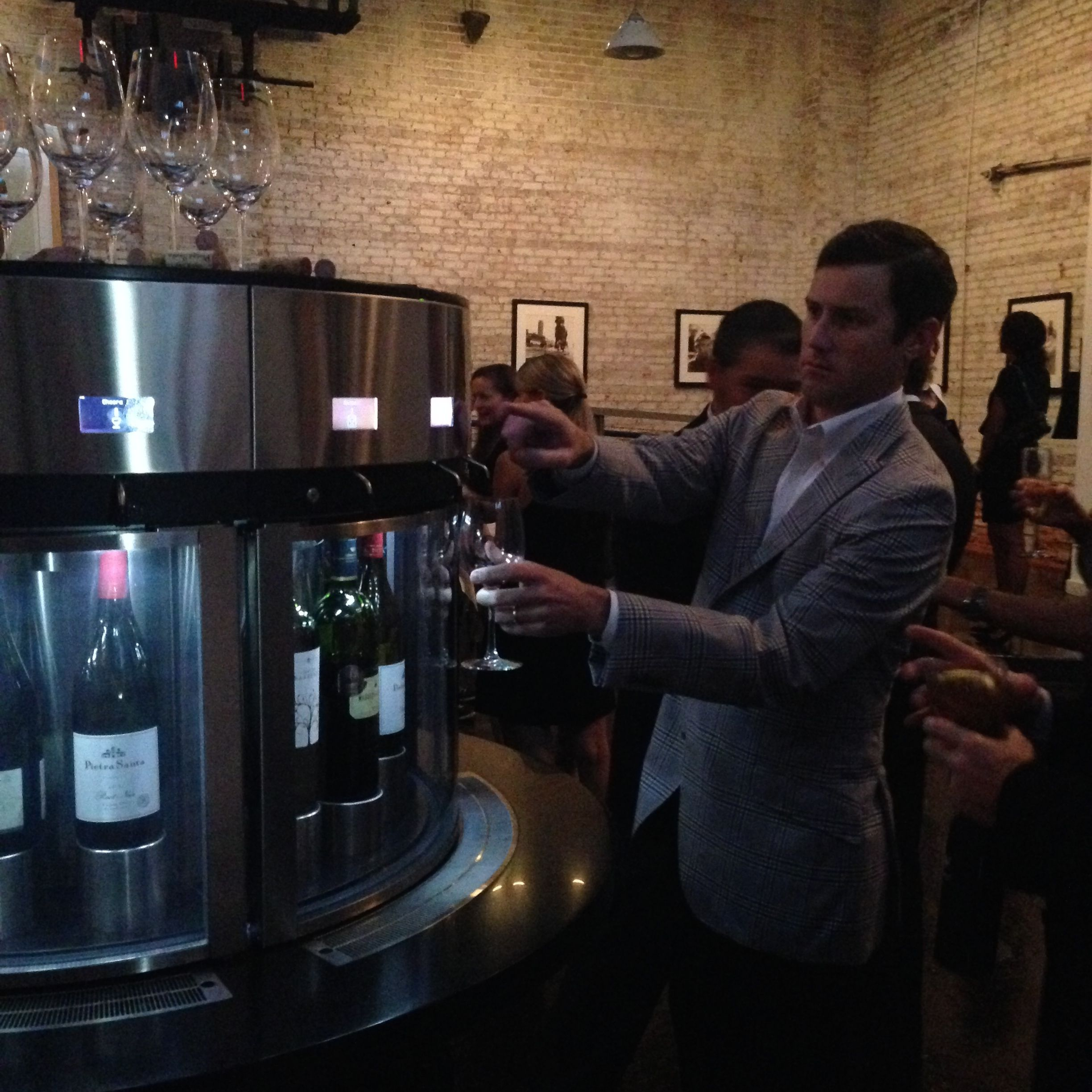 Guests poured wine from the dispenser