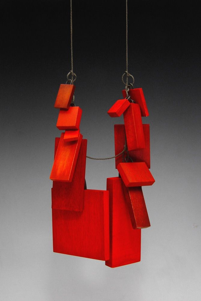 "Julia Turner ""Red Box"" pendant, 2005. Wood, stain, linen, steel. 4.7 x 3 x 1.2 in (12 x 8 x 3 cm)."