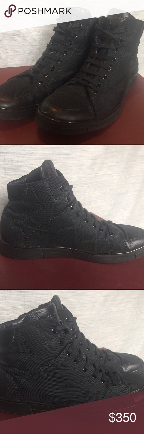Salvatore Ferragamo High Top Sneaker Men's Salvatore Ferragamo High Top Sneaker. Size 9. Pre-owned, gently used. Lace up closure, extended tongue. Made in Italy. Great condition. Salvatore Ferragamo Shoes Sneakers