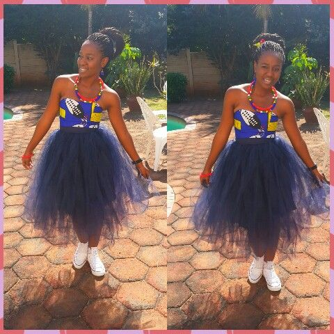 48bd2c993e4 Tulle skirt meets African print tube top! White converse tops the whole do!