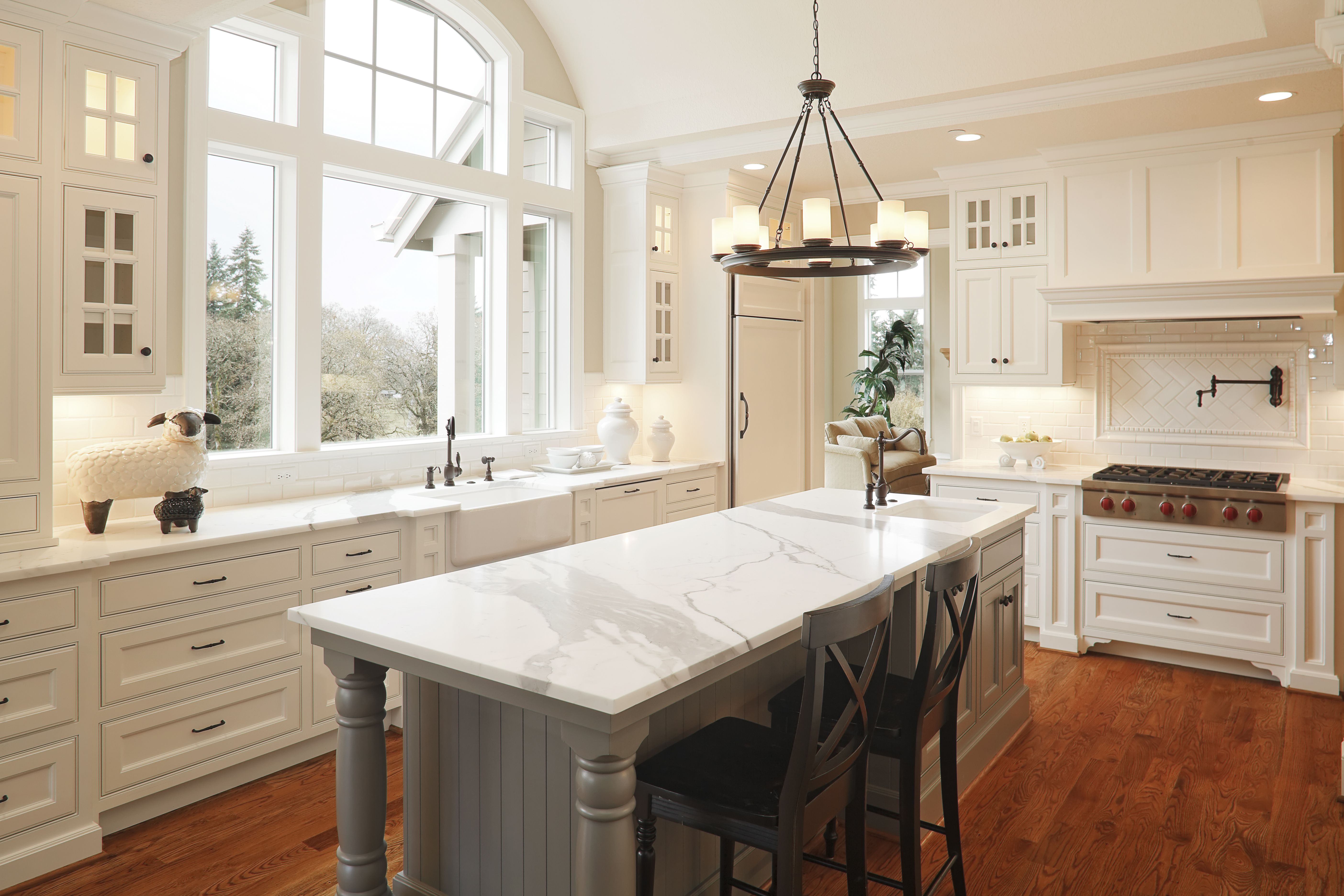 Two Toned Kitchen Cabinets with Quartz Counters and Farmhouse Sink