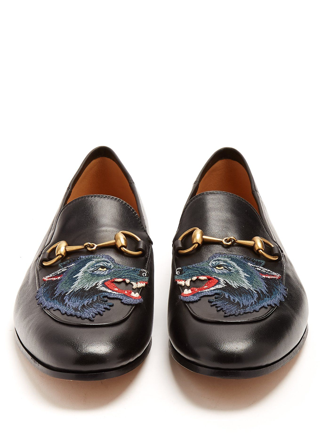 3b763671079 Click here to buy Gucci Brixton wolf-appliqué leather loafers at  MATCHESFASHION.COM