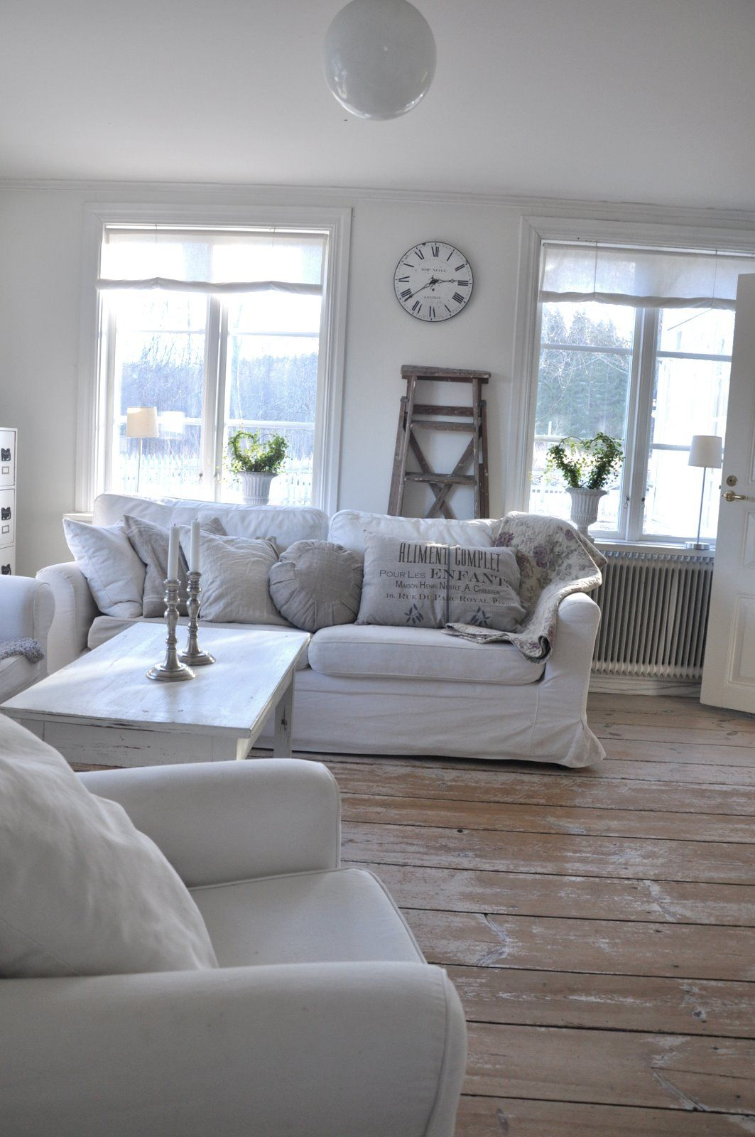 Lovely Simple And Uncluttered Living Room White Slipcovers Make The Difference In This