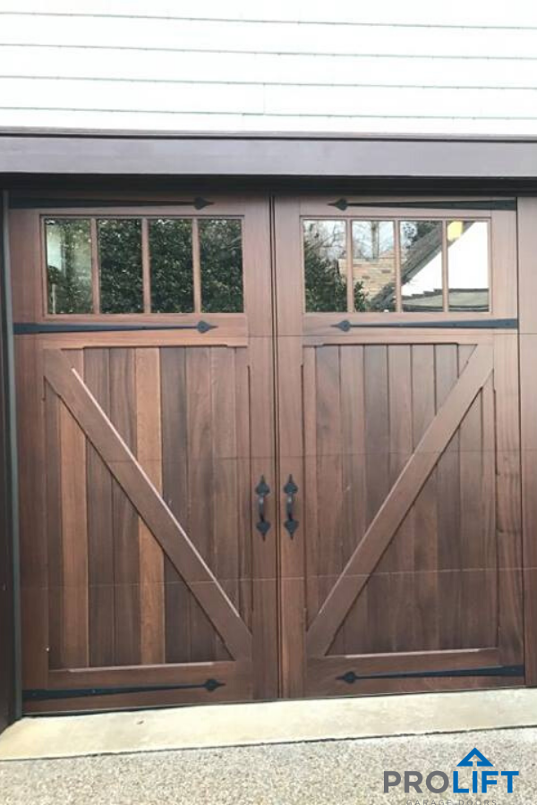 Wooden Carriage House Garage Doors With Extra Tall Windows In 2020 Garage Door Styles Garage Doors Garage Door Trim