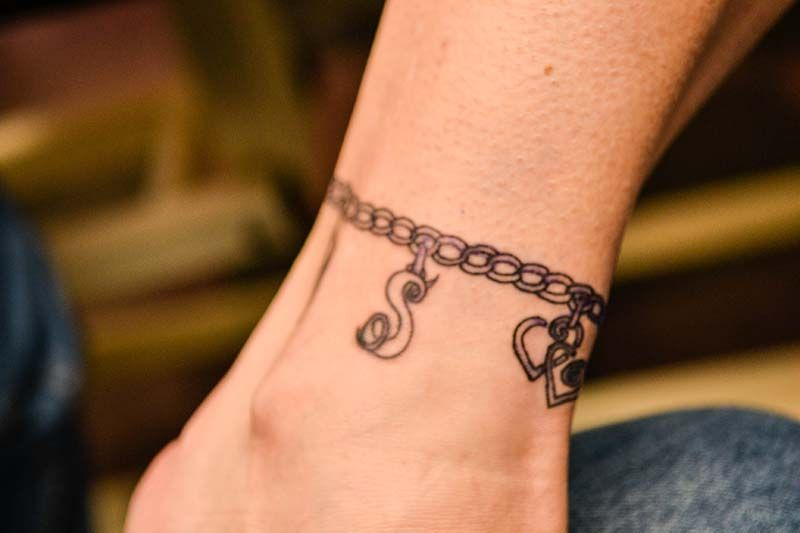 ankle charm bracelet tattoo love this add a tiny charm for different milestones events. Black Bedroom Furniture Sets. Home Design Ideas