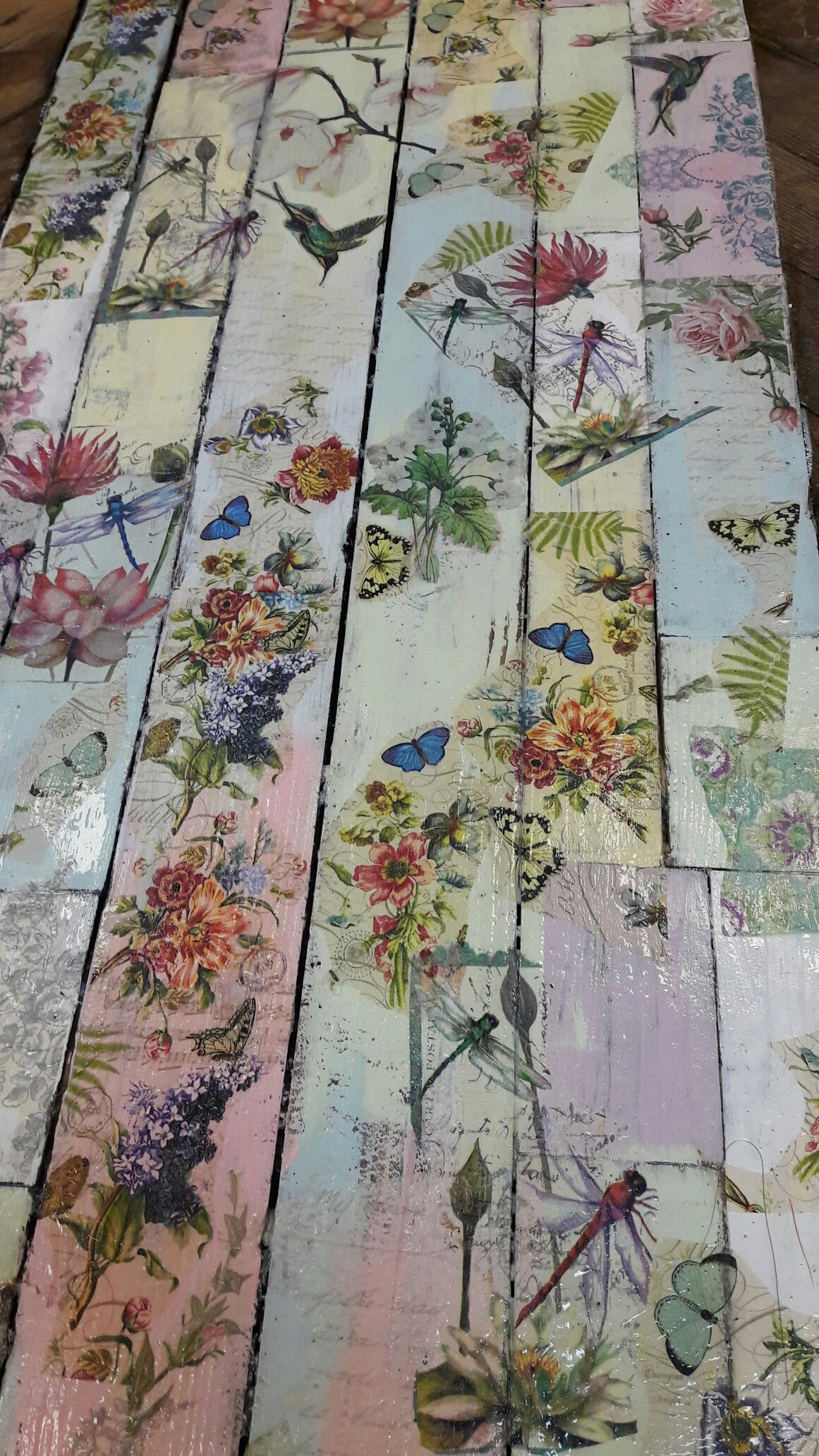Wooden floor painted with chalk paints and decoupaged with