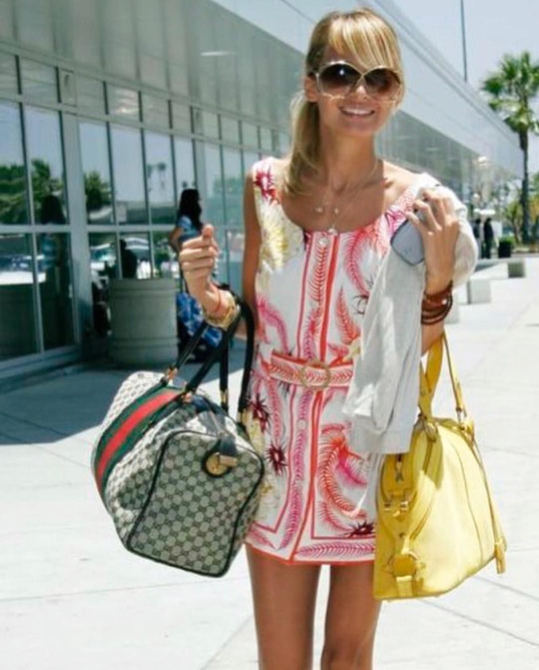 cd0a1ae9a66e7 Nicole Richie wearing vintage Emilio Pucci beach cover up, Christian Dior  butterfly sunglasses and Gucci Supreme monogram Boston bag. Styled by  Rachel Zoe.