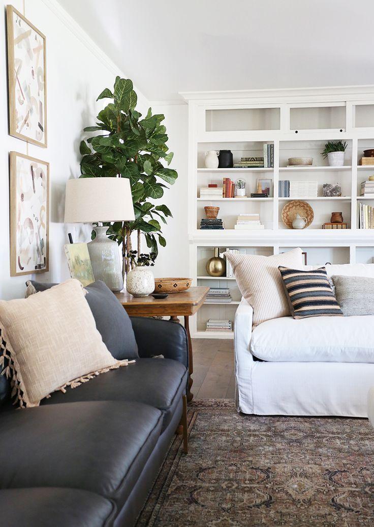 white living room design  black leather sofa  built in