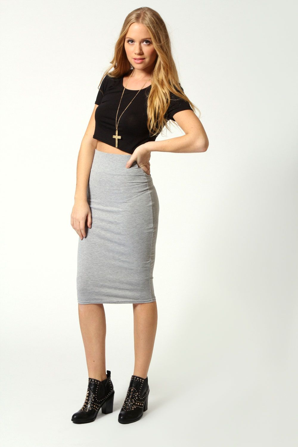 A stretch-knit bodycon dress with a midi length, a scoop neckline ...