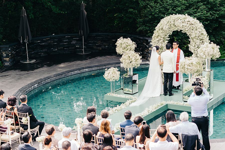 Poolside Ceremony With Clouds Of Baby's Breath And A Bride