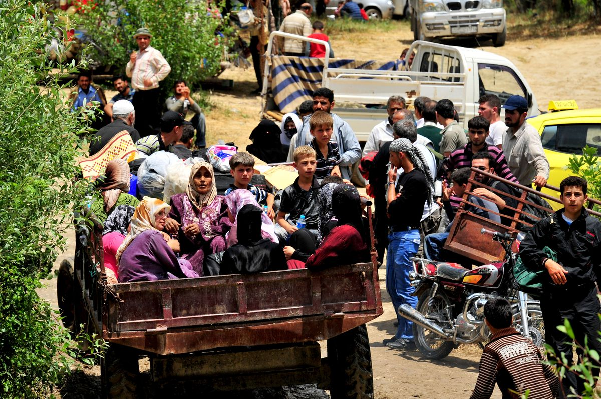 Syrian refugees arrive to a makeshift camp in the northern city of Idlib, in Turkey, on June 13 2011. (MUSTAFA OZER/AFP/Getty Images)