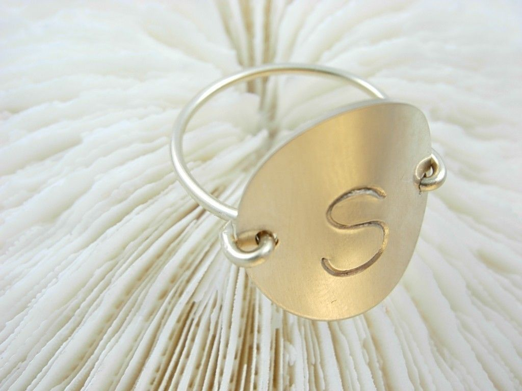 Hand Stamped 14k Gold Fill Initial (engraved) Ring. $30.00, via Etsy.