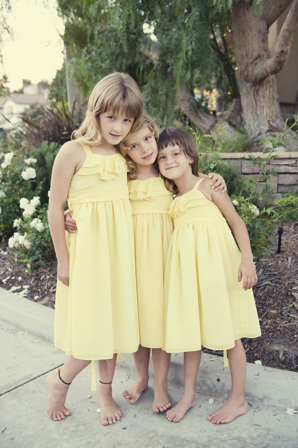 484ff2960cc Pretty pastel yellow flower girl dresses  Photo by KLK Photography