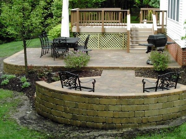 Stone Patio Design Ideas traditional stone patio design with circular sitting area Deck Design Idea Posts Related To Building The Wood And Stone Deck Designs