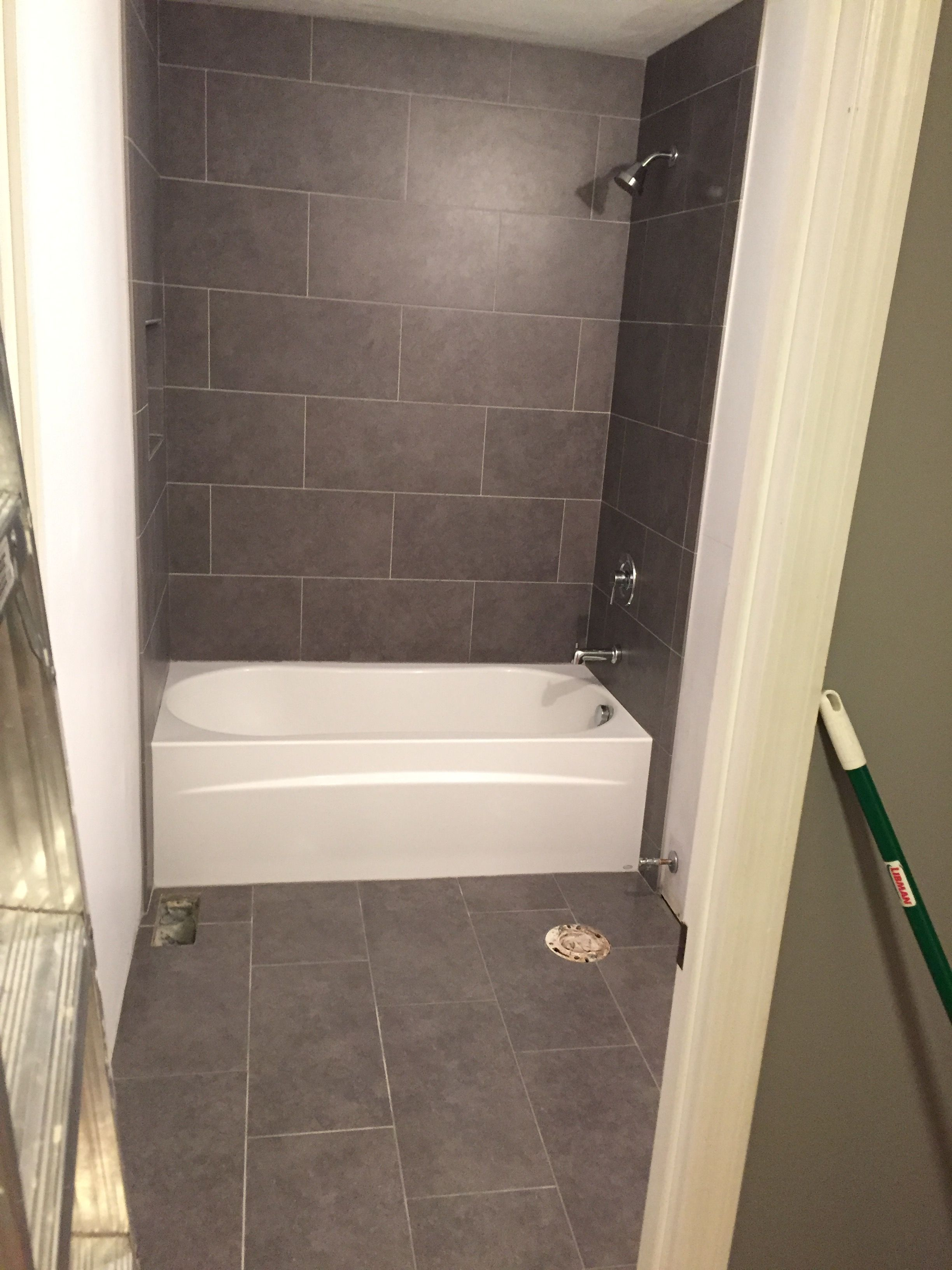 Lowe S Mitte Gray Tile 12x24 Bathroom Tub Surround And Floors Bath