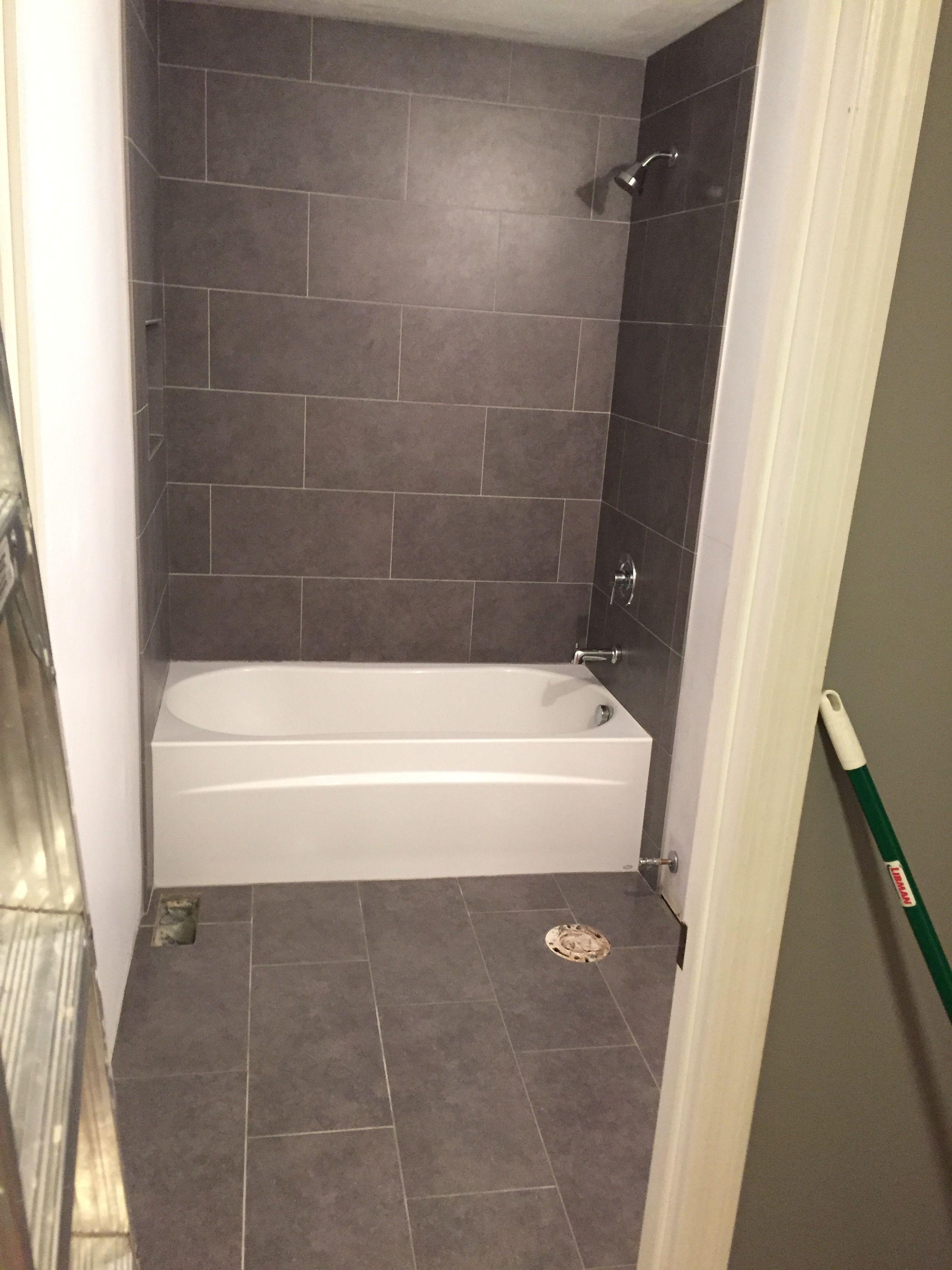 lowe s mitte gray tile 12x24 bathroom