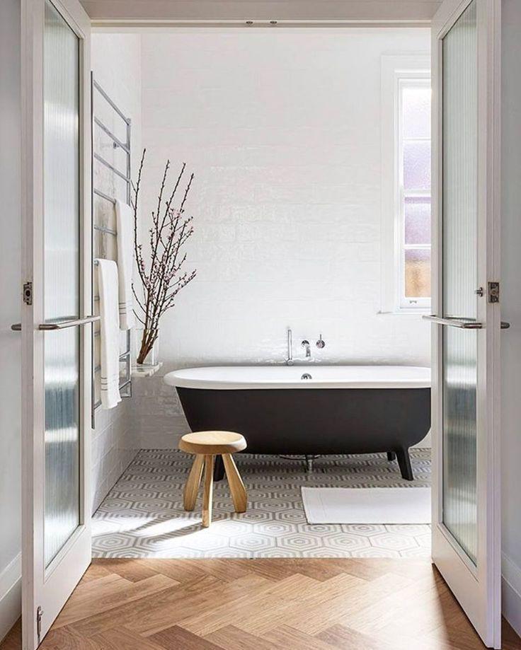 Airy modern bathroom, dark roll top bath