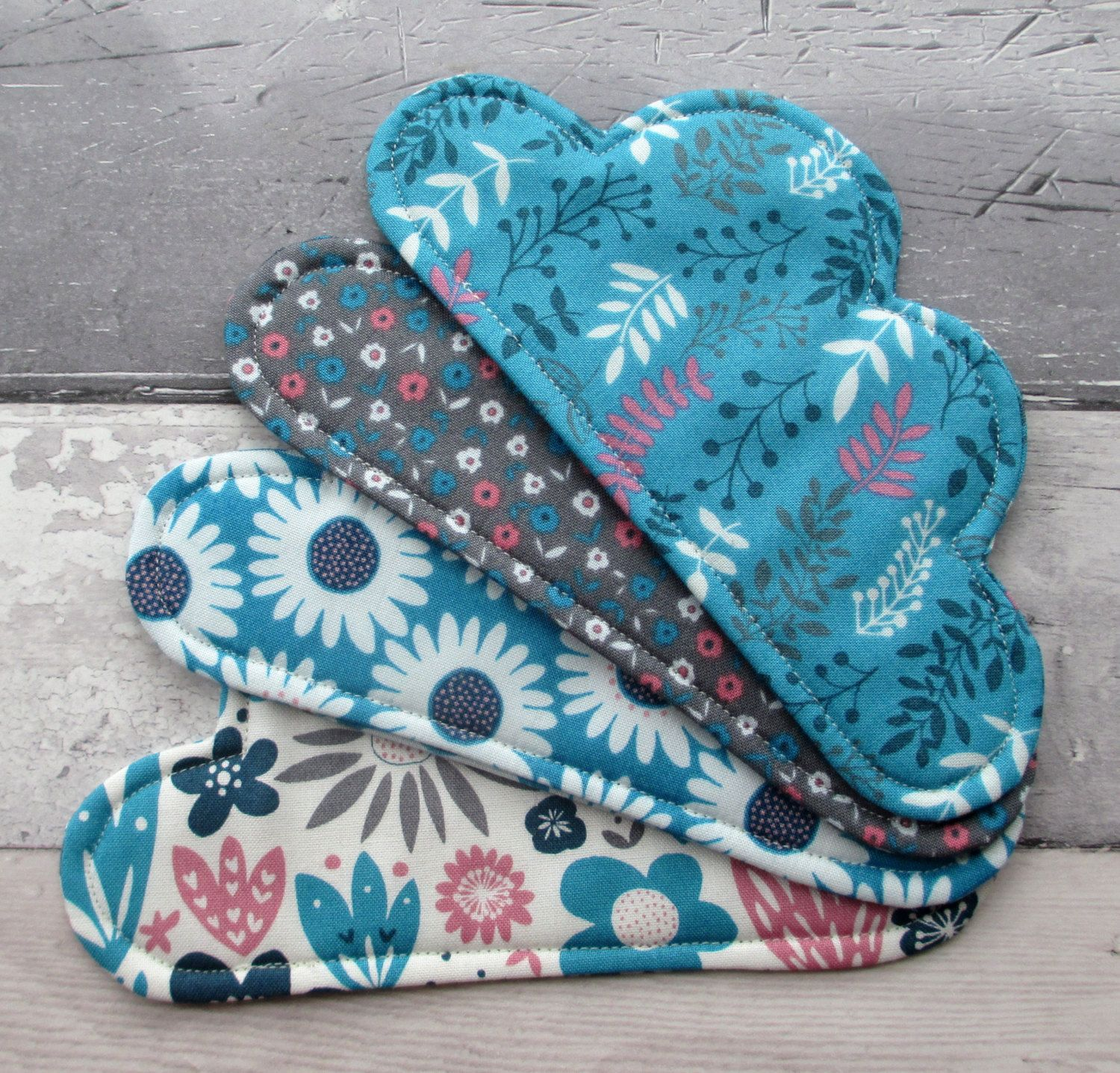A set of 4 fabric cloud coasters made with a bright and bold flower design fabric.  A fantastic gift idea to brighten up any room AND you can even a fit a biscuit on the coaster next to your mug!  Made from 100% cotton fabric and 100% cotton batting.  Dont worry if you spill your drink as the coasters are machine washable on a cool temperature, they should be dried flat and can be ironed on a cotton setting.  Shipping within the UK is via 1st class signed for delivery, shipping everywhere…