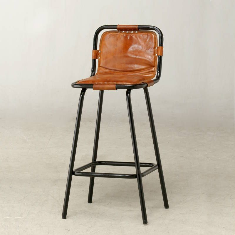 Vintage Factory bar stool featuring a tubular steel frame ...