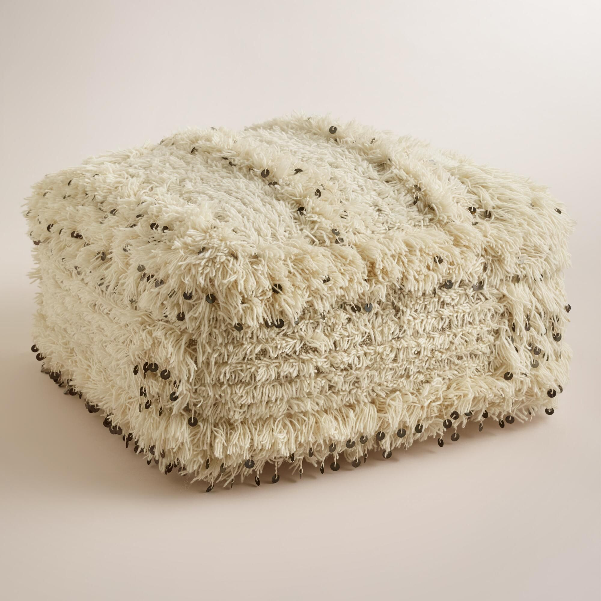 The fabric on our exclusive oversized pouf was inspired by ...