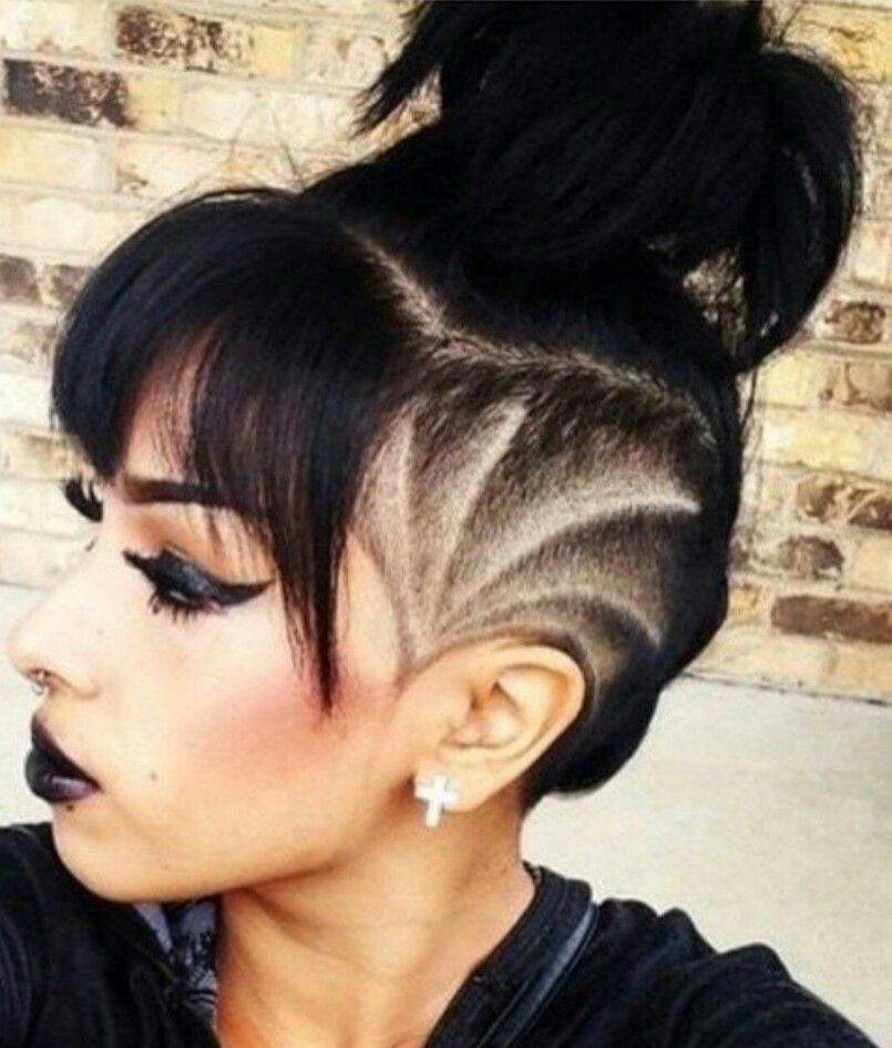 shaved sided hairstyle with bangs