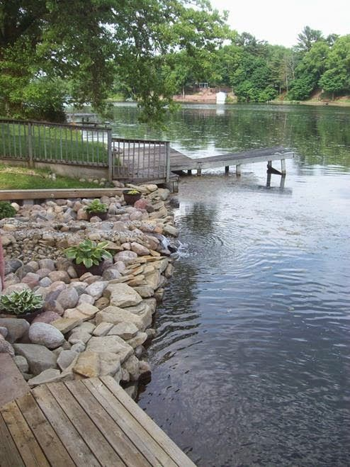 This lakeside home was enhanced even more by the homeowners vision of waterfalls leading down the hillside and into the lake. greatlakespondscapes.blogspot.com
