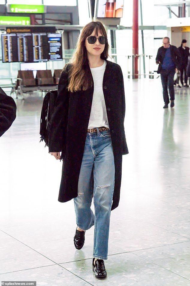 Dakota Johnson cuts stylish figure in ripped jeans and aviator shades