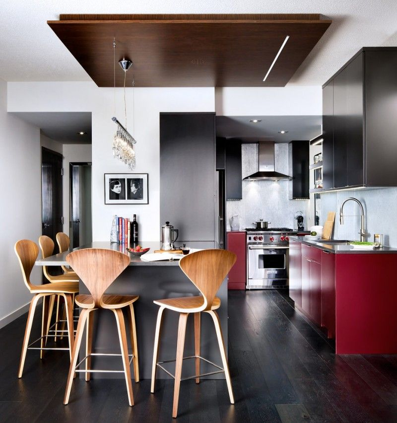 Open Kitchen In Condo With Dark Wood Floor, Grey Island