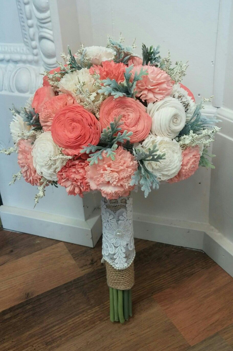 Coral & Cream Sola Wood flower bouquet. Accented with dusty miller ...