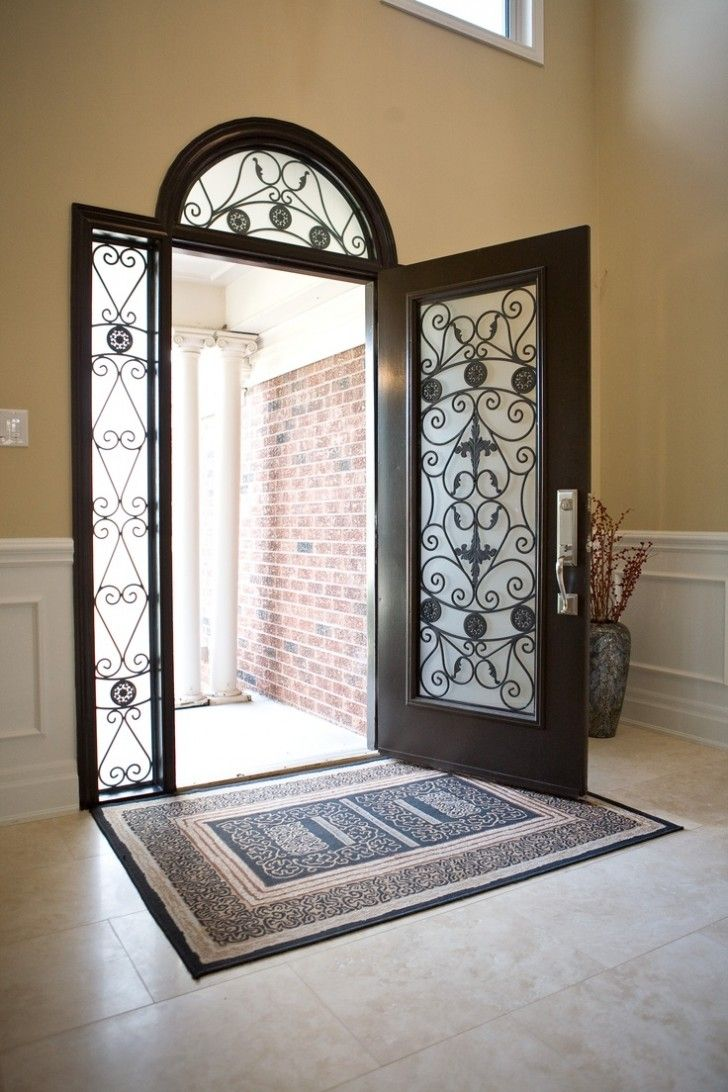 Outstanding Home Fiberglass Entry Door With Arched Style And Sidelights Added Scroll Wrought Wrought Iron Front Door Exterior House Renovation