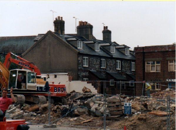 Elliotts Cottages during demolition of the old McDougal Rose building in June 1996.
