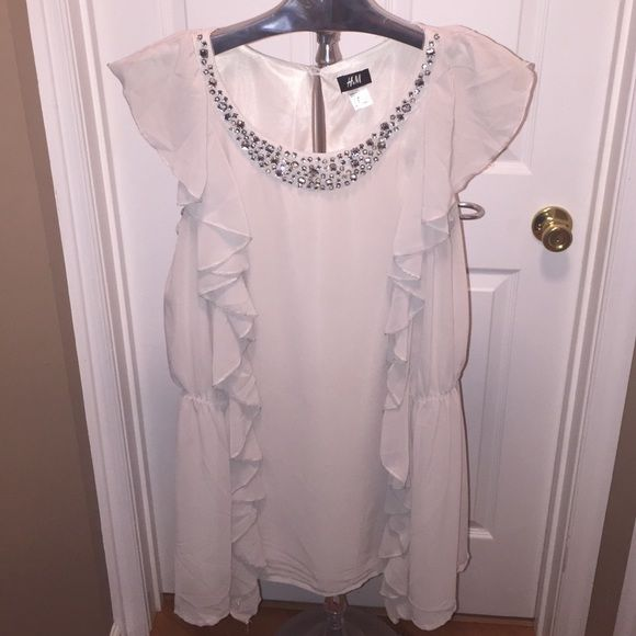 H&M rhinestone collar ruffle shirt Ruffle front, elastic sides, rhinestone collar in front. Fits long, covers midsection. One small rhinestone missing but can't even tell. Really cute. H&M Tops