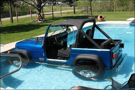 1989 Jeep Wrangler YJ taking a nice refreshing dip in the