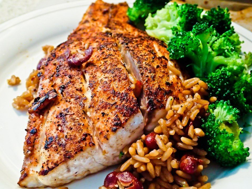 Blackened Redfish with red beans and rice and broccoli. Beautiful fish caught during a midnight SUP paddle under the stars. Blackened in the cast iron skillet using Blackened Redfish Magic seasoning from Chef Prudhomme.