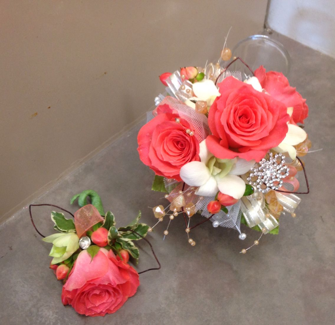 Liking the big one i am really liking the coral roses for the mom coral and white wrist corsage mightylinksfo