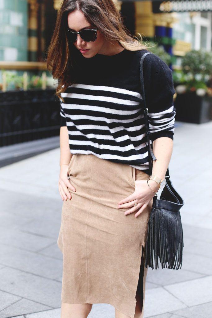 Suede pencil skirt, striped cashmere sweater, fringe bag. #style #fringe #suede #stripes