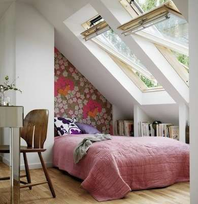 Attic Bedroom - wallpaper on the short slanted wall gives the illusion of a  headboard.