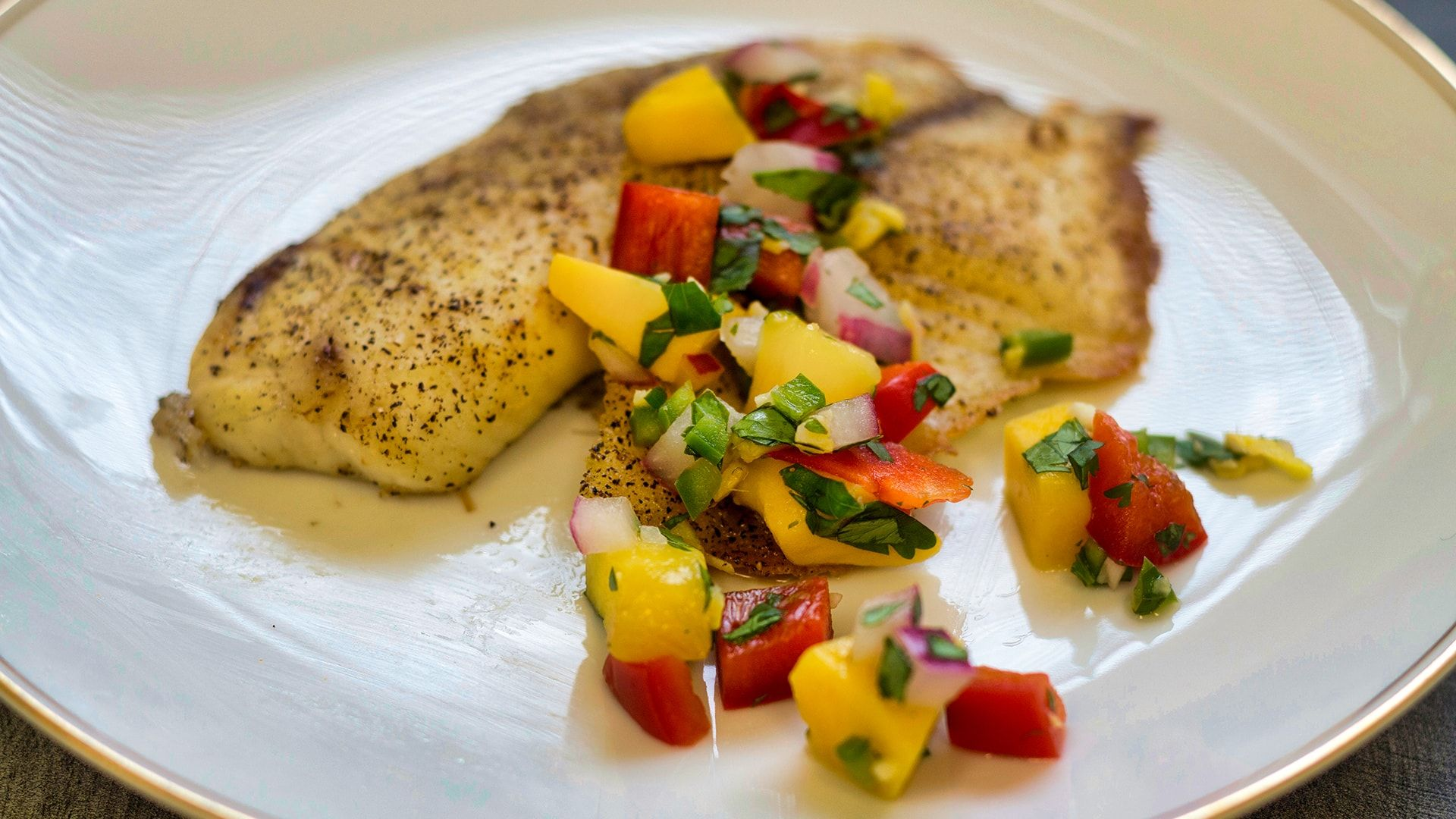 Our baked tilapia with mango salsa recipe is a brilliant