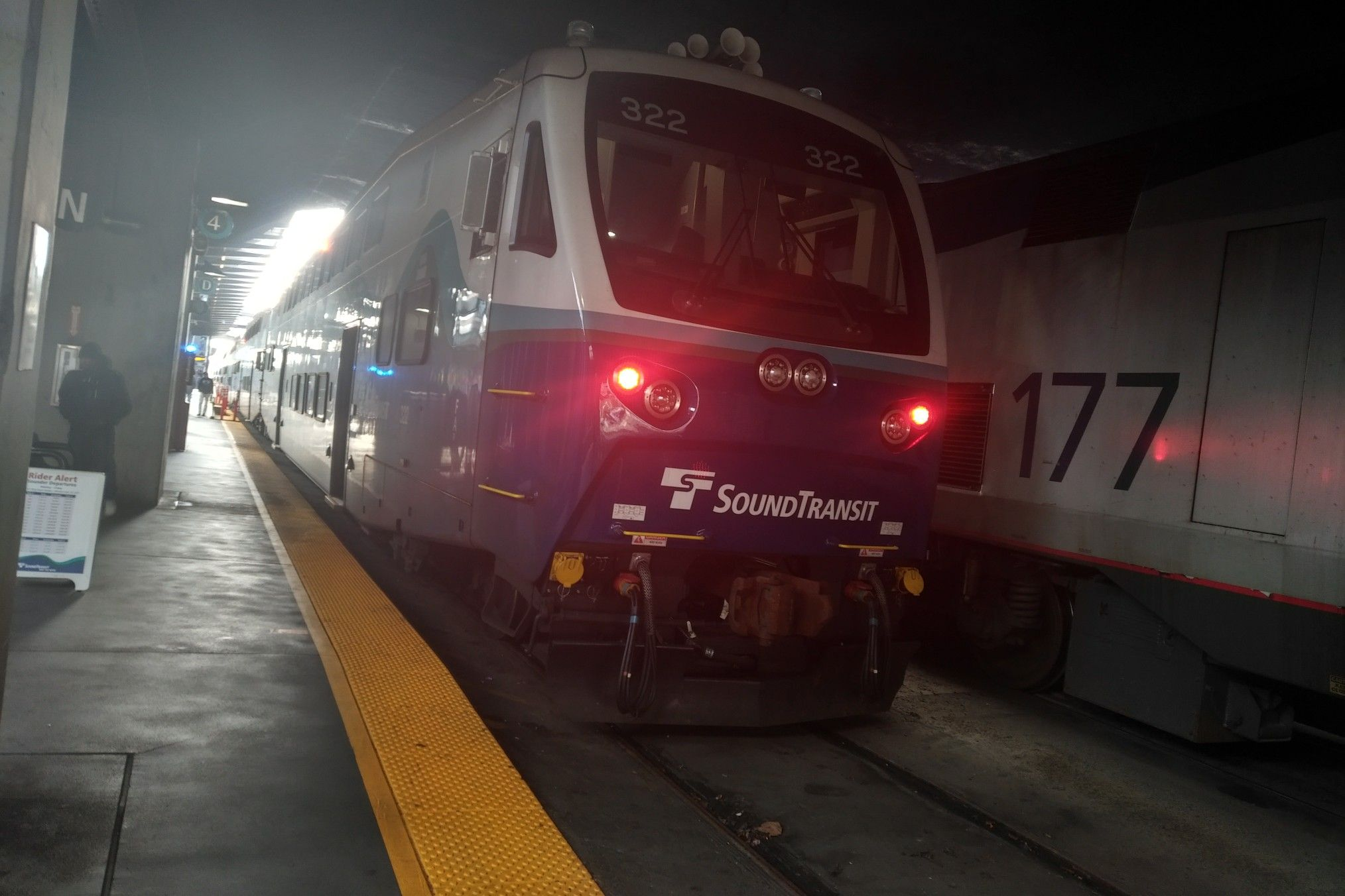 Sounder Train 1618 22 At King Street Station With Cab Car 322 Is Seen Here With Cascades Train 517 22 With Amtk 177 Trailing Seen Side By Train Passenger Cab