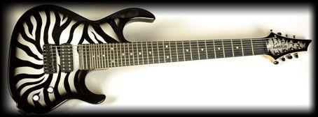 Zebra striped Conklin 8 string guitar