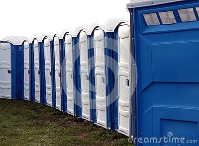 A long line of portable toilets at the fair.