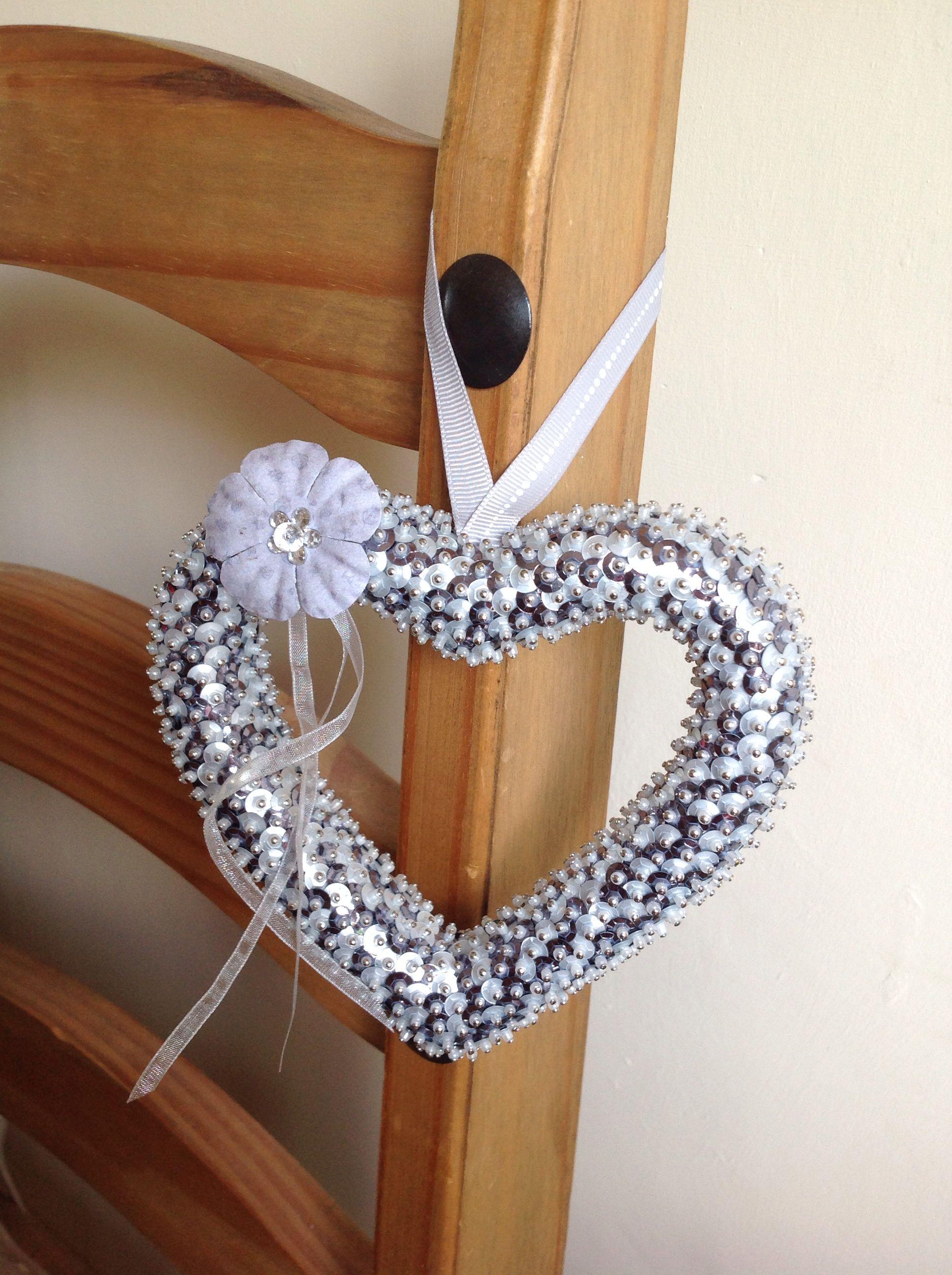 Handmade sequin heart with embellishment.