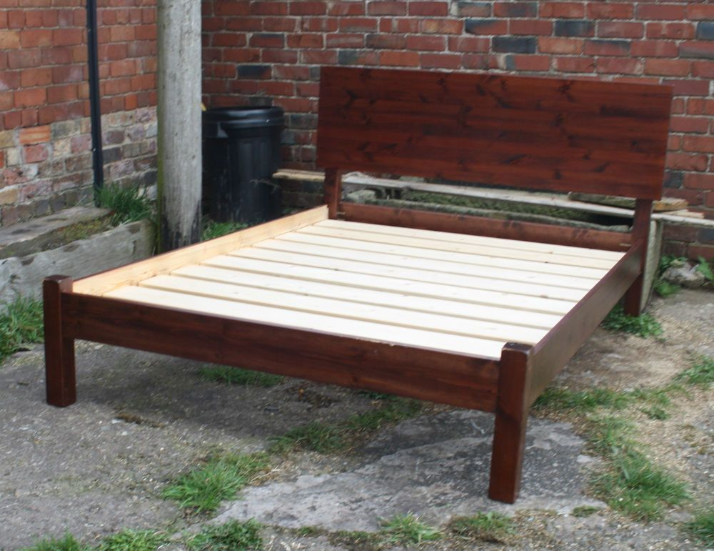 Vintage large slatted double bed  with base.
