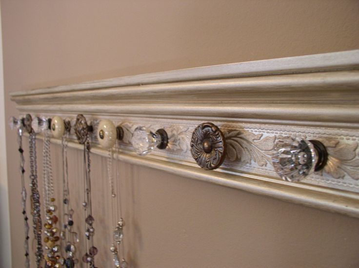 Decorative Trim Piece, Paint, Add Fun Cabinet Knobs, Mount To Closet Wall.  Great DIY Project For Displaying/organizing Necklaces. Could Use As A Coat  Rack!