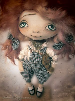 She is beautiful, sorry I cannot spell the name of the doll maker who did it...Thanks to Anna I know her name is Neonila Rozhdestvenskaya. Thank you Anna.