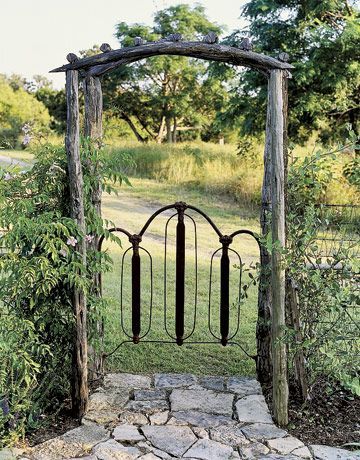 Another cute rusted headboard turned into gate