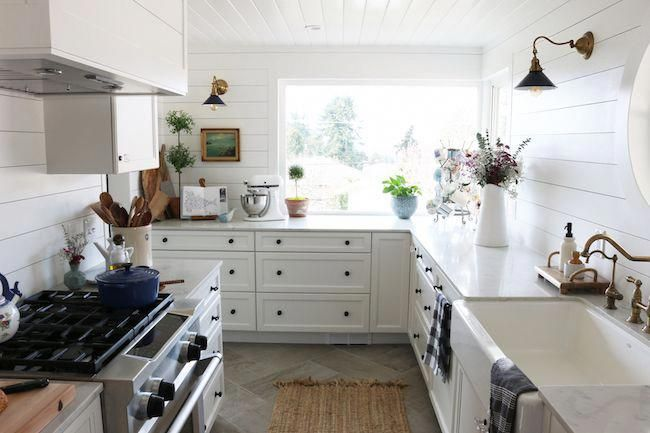 This small kitchen remodel reveal by The Inspired Room will inspire you with ideas for galley kitchens and how to add character.to a small space. #kitchenremodels #whitegalleykitchens