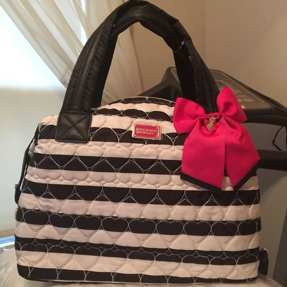 Betsey Johnson  large tote Brand new extra fancy tote inside pockets zipper closure comes with removable adjustable strap tag still on it. Betsey Johnson Bags Totes