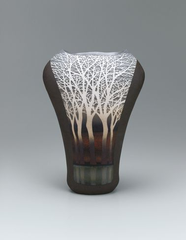 Flower vase with tree design in inlay and colored glaze painting.